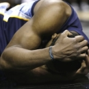 Memphis Grizzlies' Tony Allen holds his head after he was fouled by San Antonio Spurs' Manu Ginobili during the second half in Game 2 of a Western Conference Finals NBA basketball playoff series, Tuesday, May 21, 2013, in San Antonio. (AP Photo/Eric Gay)