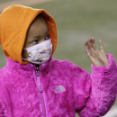FILE - In this Nov. 6, 2014 file photo, Leah Still waves during a ceremony in the first half of an NFL football game between the Cincinnati Bengals and the Cleveland Browns in Cincinnati. Bengals defensive tackle Devon Still is asking for prayers for his daughter, Leah, who's had a setback in her fight against cancer. The 5-year-old girl went into a hospital on May 5, 2015 to start the process of getting a stem cell transplant. The 4-to-6-week process involves high doses of chemotherapy at the outset. (AP Photo/AJ Mast)