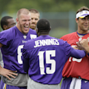Minnesota Vikings tight end Kyle Rudolph, left, laughs with wide receiver Greg Jennings (15) and quarterback Matt Cassel, right, during NFL football training camp, Monday, July 28, 2014, in Mankato, Minn The Associated Press