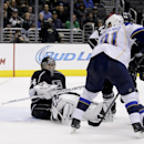 St. Louis Blues right wing Vladimir Tarasenko, left, scores past Los Angeles Kings goalie Ben Scrivens during the third period of an NHL hockey game in Los Angeles, Monday, Dec. 2, 2013 The Associated Press