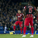 Queens Park Rangers players including Eduardo Vargas, center, wait for play to restart after Everton's first goal during the English Premier League soccer match between Everton and Queens Park Rangers at Goodison Park Stadium, Liverpool, England, Monday D