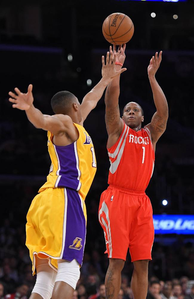 Houston Rockets guard Isaiah Canaan shoots as Los Angeles Lakers forward Wesley Johnson defends during the second half of an NBA basketball game, Tuesday, April 8, 2014, in Los Angeles. The Rockets won 145-130