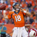 Favre says he's glad Manning will break his record The Associated Press