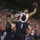 Gonzaga's Elias Harris fights for a rebound against San Diego during the first half of an NCAA basketball game in Spokane, Wash., on Saturday, Feb. 23, 2013. (AP Photo/Young Kwak)