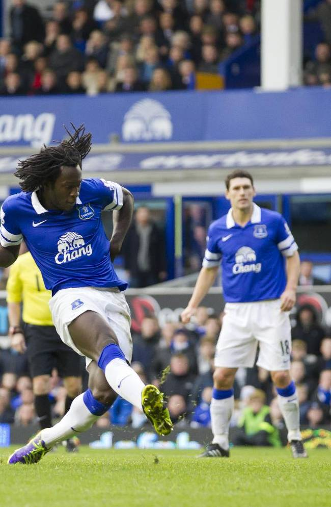 Everton's Romelu Lukaku, centre left, scores against Liverpool during their English Premier League soccer match at Goodison Park Stadium, Liverpool, England, Saturday Nov. 23, 2013