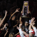 Apr 10, 2013; Louisville, KY, USA; Louisville Cardinals guard Peyton Siva (3) carries in the NCAA National Championship trophy through the crowd at the KFC YUM! Center during their celebration for winning the NCAA Men's Basketball Championship. (Jamie Rhodes-USA TODAY Sports)