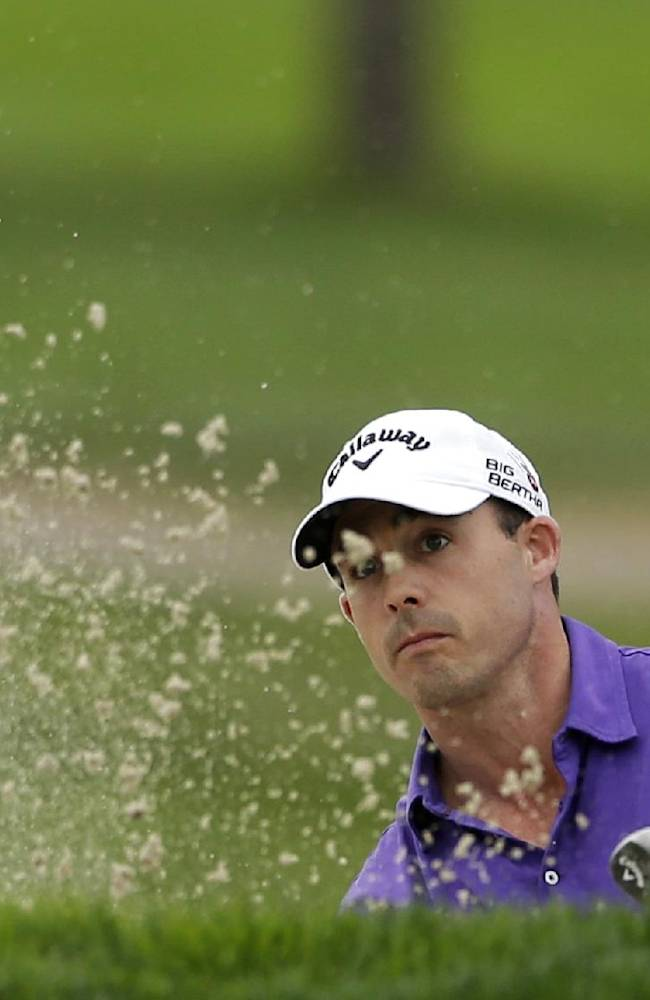 Jonathan Byrd hits out of a bunker on the eighth hole of the South Course during the second round of the Farmers Insurance Open golf tournament Friday, Jan. 24, 2014, in San Diego
