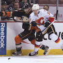 Anaheim Ducks' Ryan Kesler, left, tries to drive the puck past Calgary Flames' Corban Knight during an NHL hockey game Tuesday, Nov. 25, 2014, in Anaheim, Calif The Associated Press