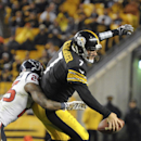 Pittsburgh Steelers quarterback Ben Roethlisberger (7) is hit by Houston Texans cornerback Kareem Jackson (25) in the backfield in the fourth quarter of the NFL football game, Monday, Oct. 20, 2014 in Pittsburgh. The Steelers won 30-23 The Associated Pres