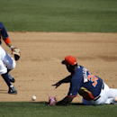 Houston Astros pitcher Jerome Williams (36) dives for the ball as second baseman Ronald Torreyes, left, comes to help but Atlanta Braves' Cedric Hunter was safe at first in the sixth inning of a spring exhibition baseball game on Sunday, March 2, 2014, in
