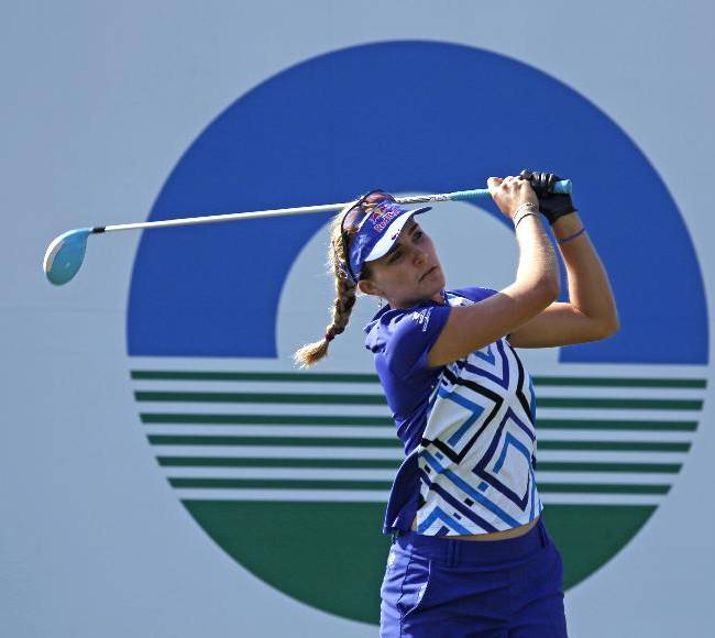 Lexi Thompson of the United States,  tees off the 1st hole during the last day of the LPGA Taiwan Championship tournament at the Sunrise Golf & Country Club, Sunday, Oct. 27, 2013, in Yangmei, northern Taiwan