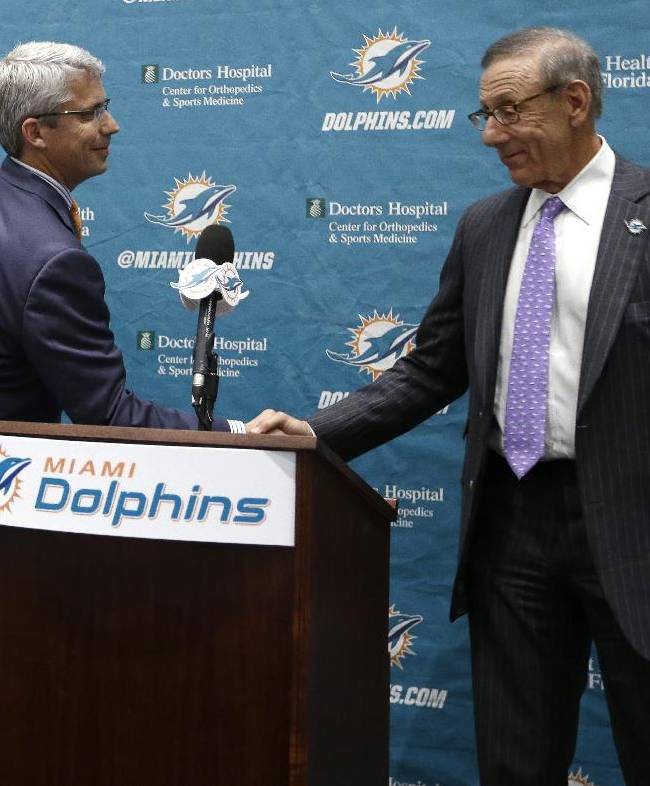 Dennis Hickey, left, the new general manager for the Miami Dolphins NFL football team, shakes hands with team owner Stephen Ross during a news conference Tuesday, Jan. 28, 2014, in Davie, Fla