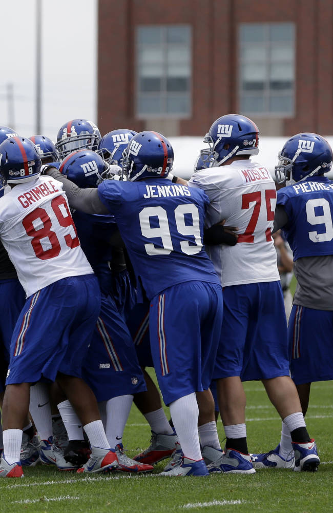 New York Giants players scuffle during practice at a NFL football camp in East Rutherford, N.J., Thursday, July 24, 2014
