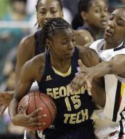 Georgia Tech's Tyaunna Marshall (15) is trapped by Maryland's Laurin Mincy (1) during the first half of the NCAA Atlantic Coast Conference women's tournament basketball championship game in Greensboro, N.C., Sunday, March 4, 2012. (AP Photo/Chuck Burton)