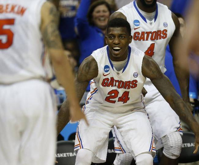 Florida forward Casey Prather (24) celebrates a three-point shot against UCLA during the second half in a regional semifinal game at the NCAA college basketball tournament, Thursday, March 27, 2014, in Memphis, Tenn. Florida won 79-68