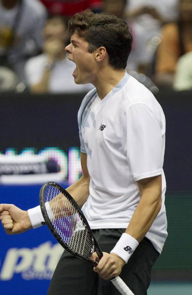Milos Raonic of Canada reacts after his win over Tomas Berdych of the Czech Republic at their final match of the Thailand Open tennis tournament in Bangkok Sunday, Sept. 29, 2013. Raonic won 7-6, 6-3