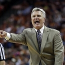 FILE - In this Feb. 23, 2013 file photo, Kansas State coach Bruce Weber argues a call during the first half on an NCAA college basketball game against Texas in Austin, Texas. Kansas State has rewarded coach Weber for winning a share of the school's first conference championship in 36 years with a raise and a one-year contract extension. (AP Photo/Eric Gay, File)