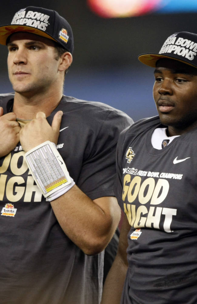 Offensive player of the game, Central Florida quarterback Blake Bortles, left, and defensive player of the game, Terrance Plummer stand on the podium after the Fiesta Bowl NCAA college football game against Baylor, Wednesday, Jan. 1, 2014, in Glendale, Ariz. Central Florida won 52-42