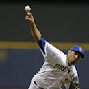 Milwaukee Brewers starting pitcher Matt Garza throws to the St. Louis Cardinals during the first inning of the MLB National League baseball game Monday, April 14, 2014, in Milwaukee The Associated Press