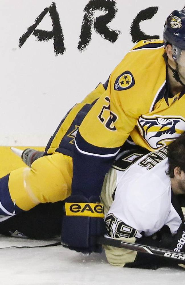 Pittsburgh Penguins forward Brian Gibbons (49) loses his helmet as he collides with Nashville Predators forward Paul Gaustad (28) in the first period of an NHL hockey game Tuesday, March 4, 2014, in Nashville, Tenn