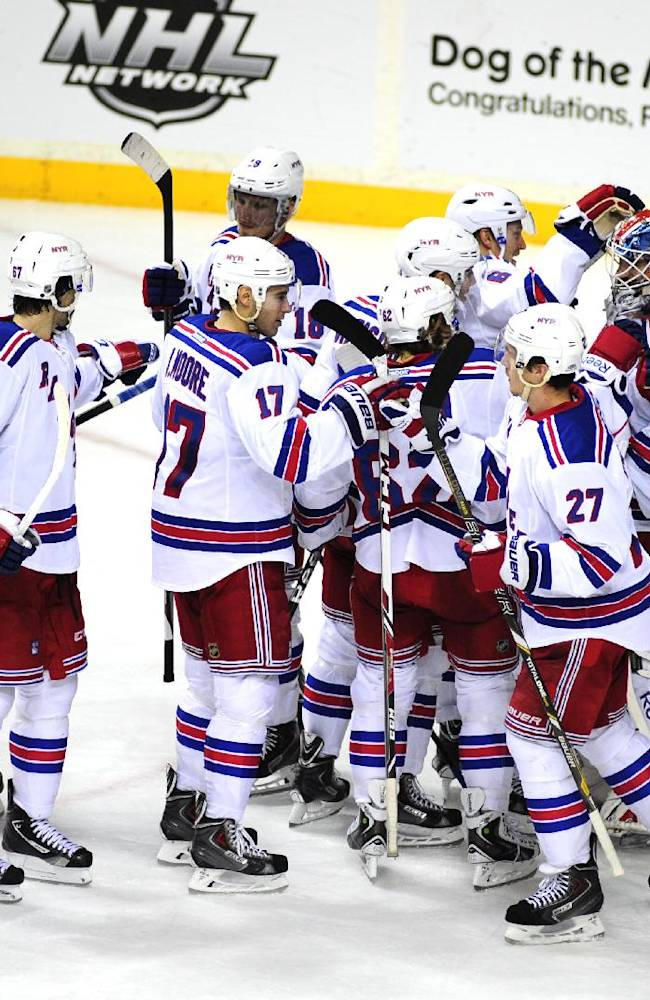 The New York Rangers celebrate after defeating the Nashville Predators 2-0 in an NHL hockey game on Saturday, Nov. 23, 2013, in Nashville, Tenn