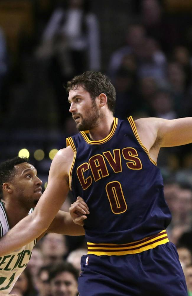 FILE - In this April 23, 2015, file photo, Cleveland Cavaliers forward Kevin Love (0) looks to pass during the first quarter of a first-round NBA playoff basketball game against the Boston Celtics in Boston. After all the speculation and intrigue surrounding Kevin Love's foray into the free agent market, the star power forward ended up right where he said he would all along _ in Cleveland. Love announced in The Players Tribune on Wednesday, July 1, 2015, that after his uneven first season ended with a serious shoulder injury, he is coming back to help LeBron James finish what they started together last season.  (AP Photo/Charles Krupa, File)