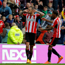 Sunderland's Steven Fletcher celebrates scoring his sides second's goal, during the English Premier League match between Sunderland and Stoke City, at the Stadium of Light, in Sunderland. England, Saturday Oct. 4, 2014