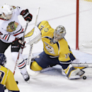 Nashville Predators goalie Pekka Rinne (35), of Finland, blocks a shot as Chicago Blackhawks right wing Ben Smith (28) watches for the rebound in the second period of an NHL hockey game Thursday, Oct. 23, 2014, in Nashville, Tenn The Associated Press