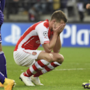 Arsenal's Aaron Ramsey covers his face after missing an opportunity to score during the Group D Champions League match between Anderlecht and Arsenal at Constant Vanden Stock Stadium in Brussels, Belgium, Wednesday Oct. 22, 2014
