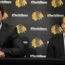 Chicago Blackhawks players Jonathan Toews, left, and Patrick Kane smile during a news conference at the United Center in Chicago, Wednesday, July 16, 2014. The Blackhawks recently agreed to eight-year contract extensions with for their star players The A