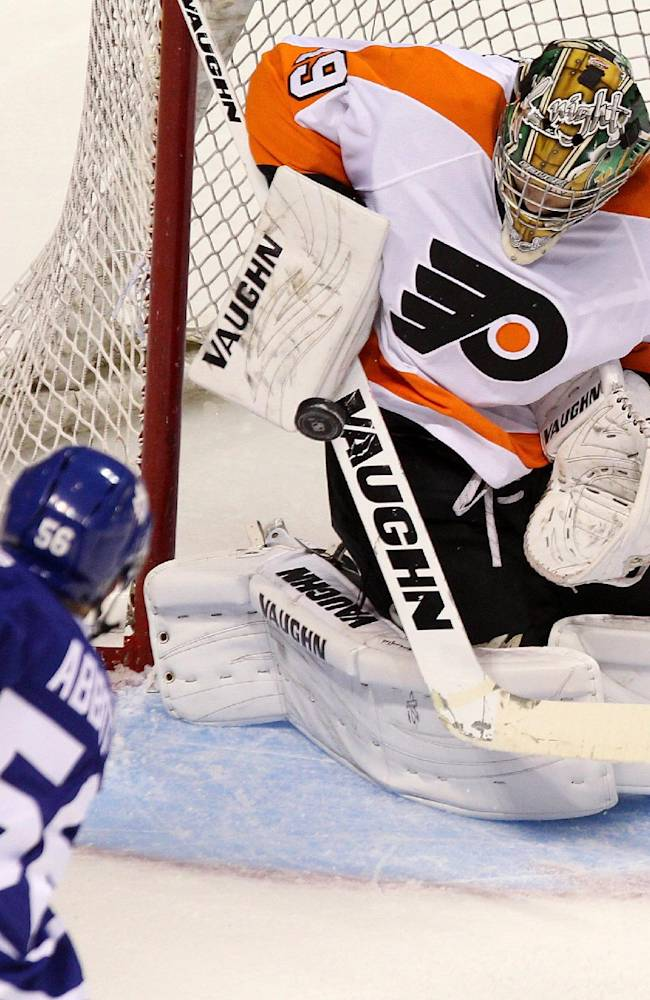 Toronto Maple Leafs' Spencer Abbott shoots on Philadelphia Flyers' goalie Anthony Stolarz during the third period of an NHL pre-season game, Sunday Sept. 15, 2013 in London, Ontario