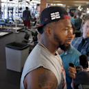 Arizona Cardinals' Darnell Dockett pauses before answering a question as he talks with reporters during the first phase of the voluntary offseason training program at the NFL football team's training facility on Thursday, April 24, 2014, in Tempe, Ariz Th