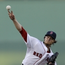 Boston Red Sox starting pitcher Clay Buchholz pitches in the first inning of an exhibition baseball game against the New York Yankees in Fort Myers, Fla., Thursday, March 20, 2014 The Associated Press