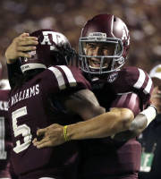 Texas A&M quarterback Johnny Manziel, right, celebrates with teammate Brandon Williams (5) after throwing a touchdown pass to Williams during the third quarter of an NCAA college football game against Sam Houston State, Saturday, Sept. 7, 2013, in College Station, Texas. (AP Photo/David J. Phillip)