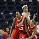 Mississippi's Nikki Byrd (22) and Kayla Melson, right, battle with South Carolina forward Ashley Bruner, center, for the ball in the first half of an NCAA college basketball game at the Southeastern Conference tournament on Thursday, March 3, 2011, in Nashville, Tenn. (AP Photo/Mark Humphrey)