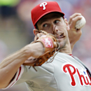 Philadelphia Phillies starting pitcher Cliff Lee delivers the ball to the Texas Rangers during the fourth inning of an opening day baseball game at Globe Life Park, Monday, March 31, 2014, in Arlington, Texas The Associated Press