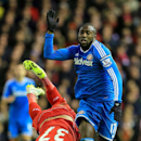 Sunderland's Jozy Altidore, right, and Liverpool's Martin Skrtel battle for the ball during the English Premier League soccer match at Anfield, Liverpool, England, Saturday Dec. 6, 2014