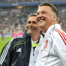 FILE - In this Friday, Aug. 13, 2010 file photo, Munich's head coach Louis van Gaal, right, and Madrid's head coach Jose Mourinho smile prior to the friendly soccer match between FC Bayern Munich and Real Madrid in Munich, southern Germany. Manche