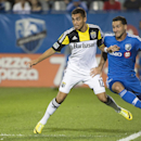 Montreal Impact's Dilly Duka, right, and Columbus Crew's Hector Jimenez battle for the ball during second half MLS soccer action in Montreal, Saturday, Aug. 30, 2014 The Associated Press