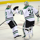 Dallas Stars' Erik Cole, left, and goaltender Kari Lehtonen, of Finland, celebrate after they defeated the New Jersey Devils 3-2 in a shootout at an NHL hockey game Friday, Oct. 24, 2014, in Newark, N.J The Associated Press