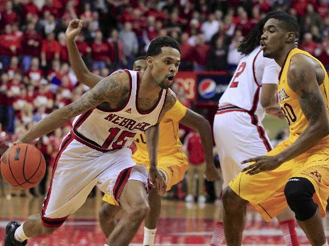 In this March 6, 2013 file photo, Nebraska's Ray Gallegos (15) drives past Minnesota's Andre Ingram, right, in an NCAA college basketball game in Lincoln, Neb.  Nebraska will have one of the best venues in the nation with the opening of the $179 million Pinnacle Bank Arena, but whether the product on the floor is better in coach Tim Miles' second season is a mystery