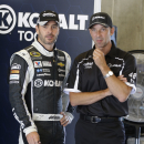 Driver Jimmie Johnson, left, talks with crew chief Chad Knaus before practice for the Brickyard 400 Sprint Cup series auto race at the Indianapolis Motor Speedway in Indianapolis, Friday, July 25, 2014. (AP Photo/Darron Cummings)