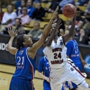 South Carolina forward Aleighsa Welch (24) shoots over the top of Kansas forward Carolyn Davis (21) in the first half of a second-round game of the women's NCAA college basketball tournament on Monday, March 25, 2013, in Boulder. Colo. (AP Photo/ Ed Andrieski)