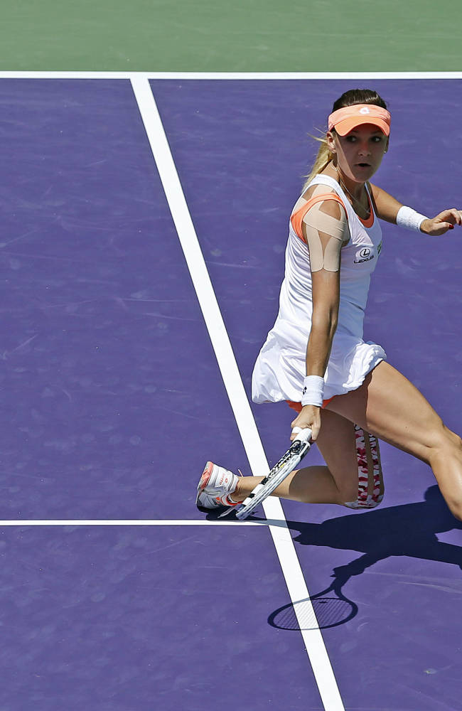 Agnieszka Radwanska, of Poland, returns to Dominika Cibulkova, of Slovakia, at the Sony Open Tennis tournament in Key Biscayne, Fla., Wednesday, March 26, 2014