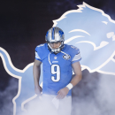 File- This Nov. 9, 2014, file photo shows Detroit Lions quarterback Matthew Stafford during player introductions before an NFL football game against the Miami Dolphins at Ford Field in Detroit The Associated Press