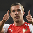 Arsenal's Lukas Podolski gives two thumbs up at the end of the Group D Champions League match between Anderlecht and Arsenal at Constant Vanden Stock Stadium in Brussels, Belgium, Wednesday Oct. 22, 2014. Arsenal won the match with a 2-1 score