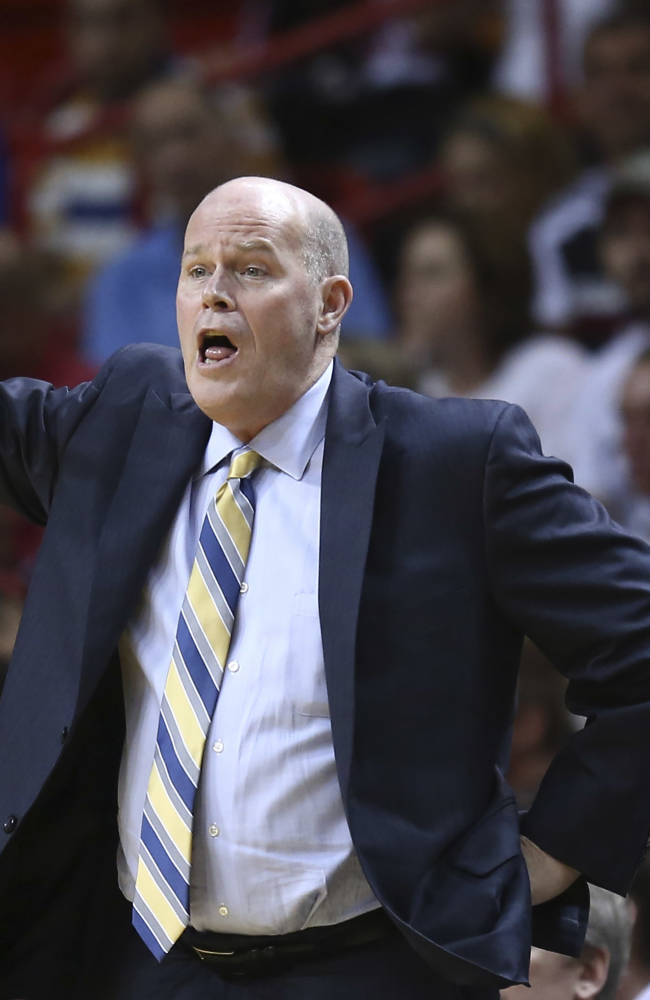 Charlotte Bobcats coach Steve Clifford yells instructions to his team as they play the Miami Heat during the first half of an NBA basketball game in Miami, Monday, March 3, 2014
