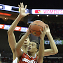 Louisville's Quentin Snider, front, attempts to shoot over the defense of Louisville's Anas Mahmoud during the first half of an NCAA college basketball scrimmage Sunday, Oct. 19, 2014, in Louisville, Ky. (AP Photo/Timothy D. Easley)