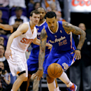 Los Angeles Clippers forward Matt Barnes (22) chases down the loose ball as Phoenix Suns guard Goran Dragic, Slovenia, looks on during the first half of an NBA basketball game on Wednesday, April 2, 2014, in Phoenix The Associated Press