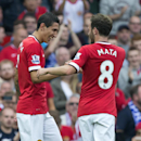 Manchester United's Angel Di Maria, left, celebrates with teammate Juan Mata after scoring against Queens Park Rangers during their English Premier League soccer match at Old Trafford Stadium, Manchester, England, Sunday Sept. 14, 2014